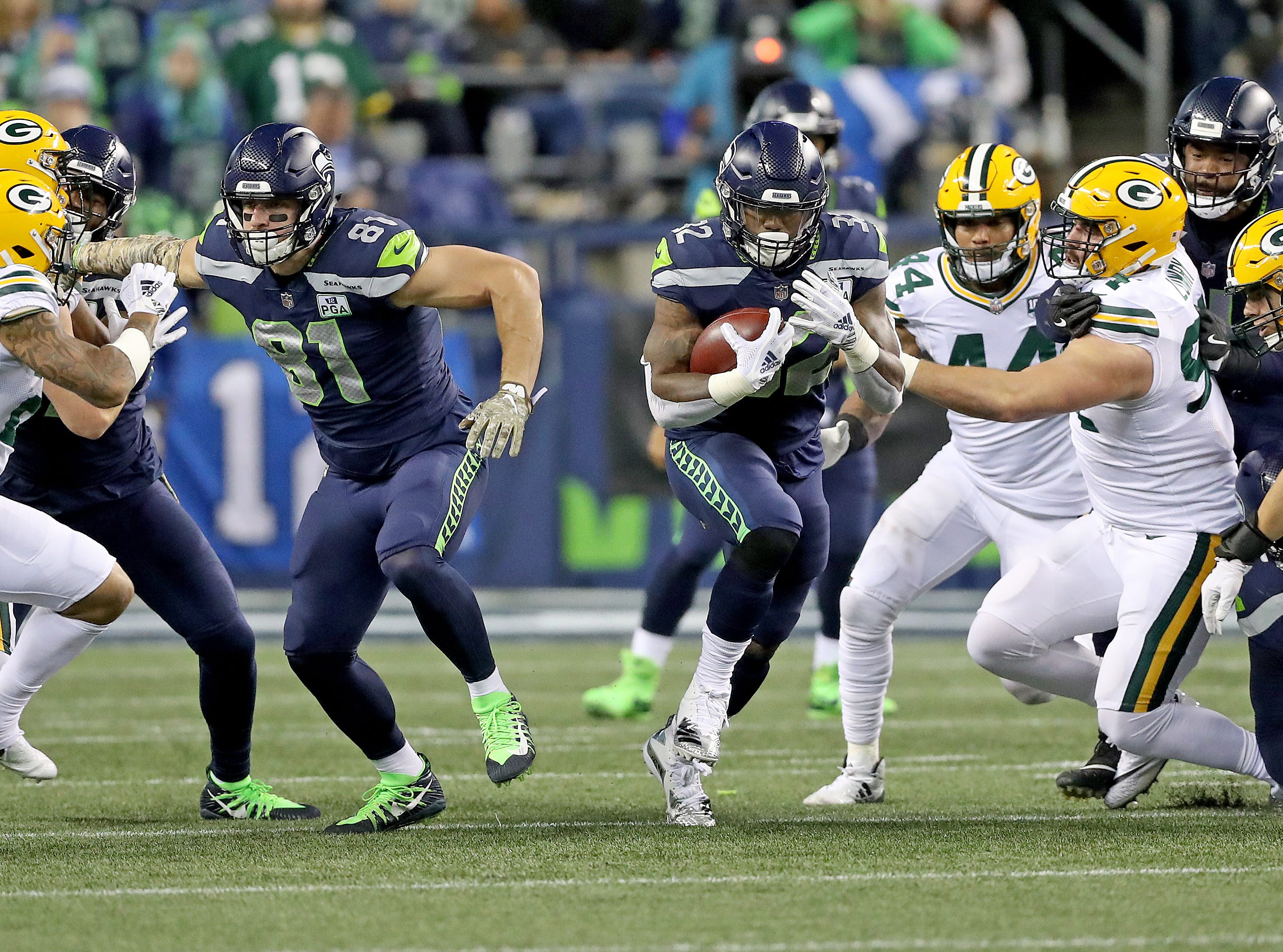 Green Bay Packers defensive end Dean Lowry (94) and cornerback Jaire Alexander (23) can't close a gaping home in the defensive line as running back Chris Carson (32) runs to the second level against the Seattle Seahawks at CenturyLink Field Thursday, November 15, 2018 in Seattle, WA. Jim Matthews/USA TODAY NETWORK-Wis