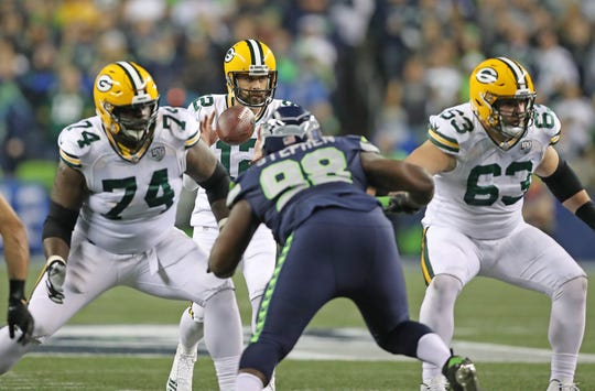 Green Bay Packers quarterback Aaron Rodgers (12) takes the snap as center Corey Linsley (63) and offensive guard Byron Bell (74) block against the Seattle Seahawks at CenturyLink Field Thursday, November 15, 2018 in Seattle, WA. Jim Matthews/USA TODAY NETWORK-Wis