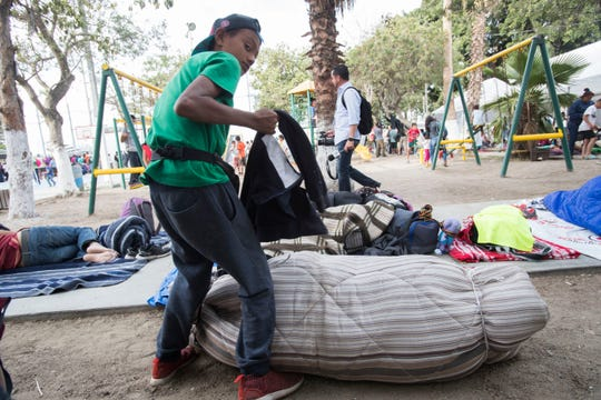 Nearly 1600 migrants have arrived to Tijuana, Mexico since Tuesday. An emergency shelter was set up at the Benito Juarez Sports Complex just a few hundred feet from the U.S./Mexico border. In this photo a young child prepares his bed.