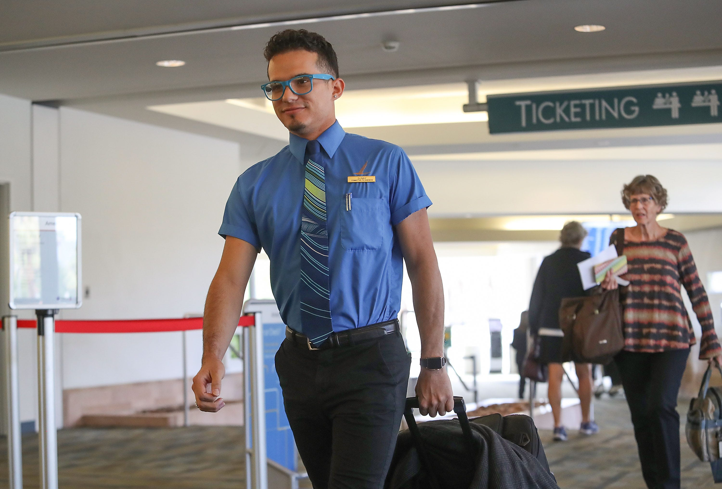 Sammy Vargas, a flight attendant with Alaska Airlines walks through the Palm Springs International Airport, November 16, 2018.