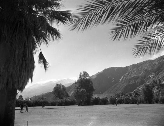 Gorgeous expanse of the golf course looking out to Tahquitz Canyon beyond.