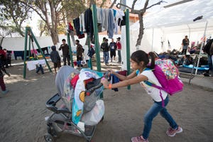 About 2,000 migrants had arrived at the Benito Juarez sports complex in Tijuana, Mexico, as of Nov 16, 2018. But only two restrooms were available for women and men.