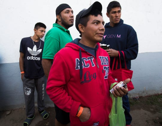 About 2,000 migrants have arrived at the Benito Juarez sports complex in Tijuana as of Friday, there were only two bathrooms available for women and men. In this photo clean and mingle during the morning.