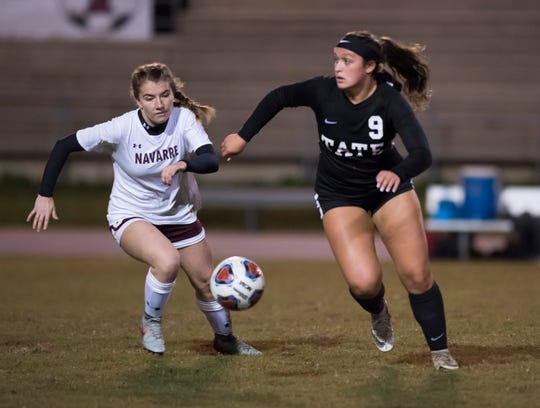 Tate High School's Kaley Mincy, (No. 9) and Navarre High School's Jocelyn Fernandez, (No. 5) battle for possession of the ball during the Aggies home opener against Navarre on Thursday night, Nov. 15, 2018.