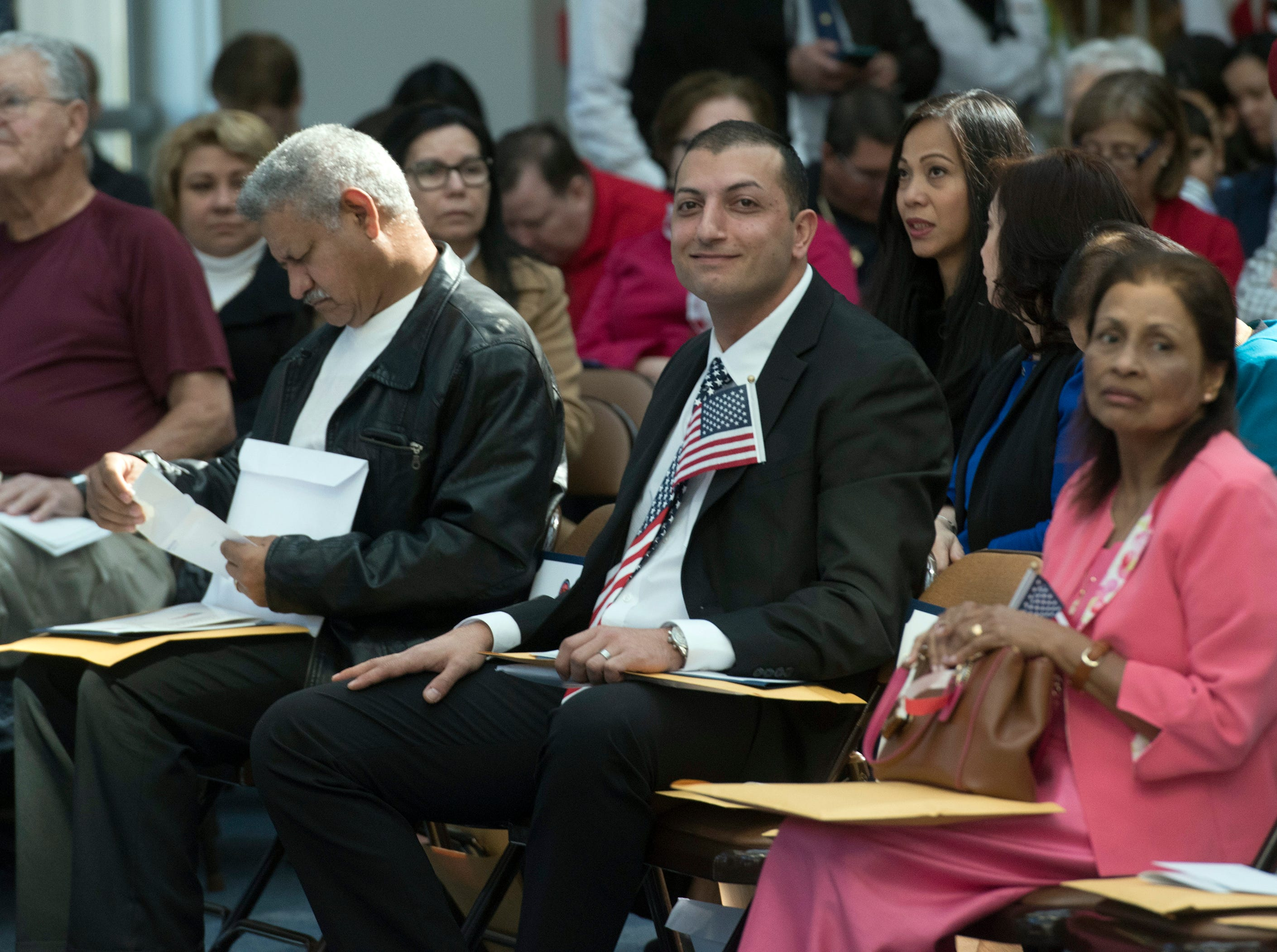 American welcomes news citizens during a Naturalization Ceremony at NASP
