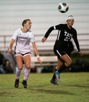 Navarre High School's Jennifer Seward, (No. 22) and Tate High School's Kendall Blackmon, (No. 23) battle for possession during Tate's home opener on Thursday night, Nov. 15, 2018.