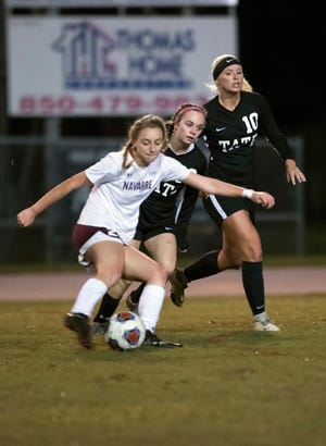 Navarre High School's Jennifer Seward, (No. 22) wind up for a shot on goal as Tate High School's Alyssa Pope, (No. 16) and, Makenna Stafford (No.10  ) apply pressure during Tate's home opener on Thursday night, Nov. 15, 2018.