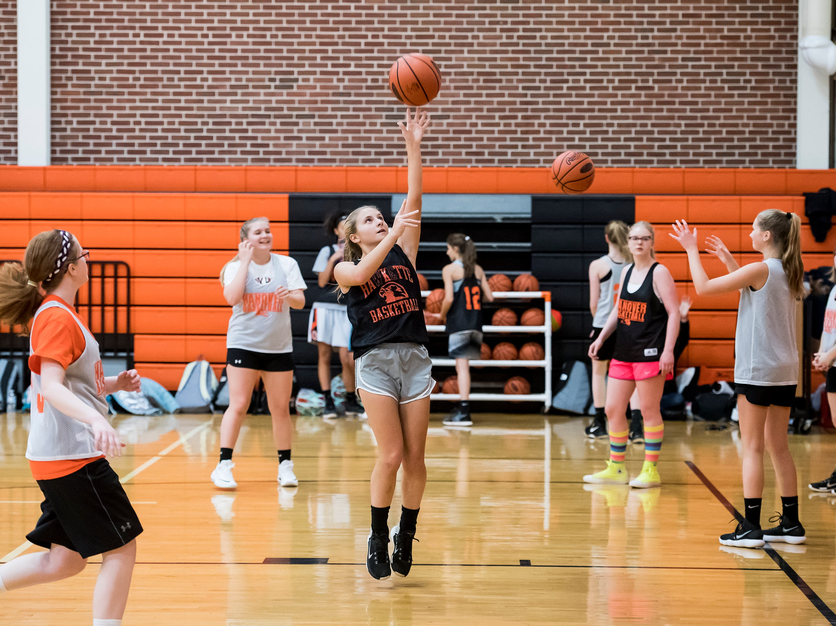 Hanover basketball player Sydney Delong, center, shoots the ball during the first official day of winter sports practice on Friday, November 16, 2018.