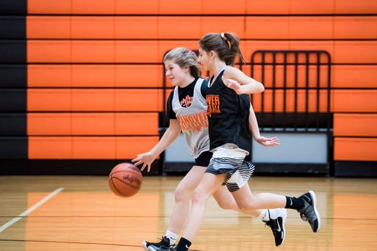 Hanover basketball players Saige Stevens, left, and Jaycie Miller run through a drill during the first official day of winter sports practice on Friday, November 16, 2018.