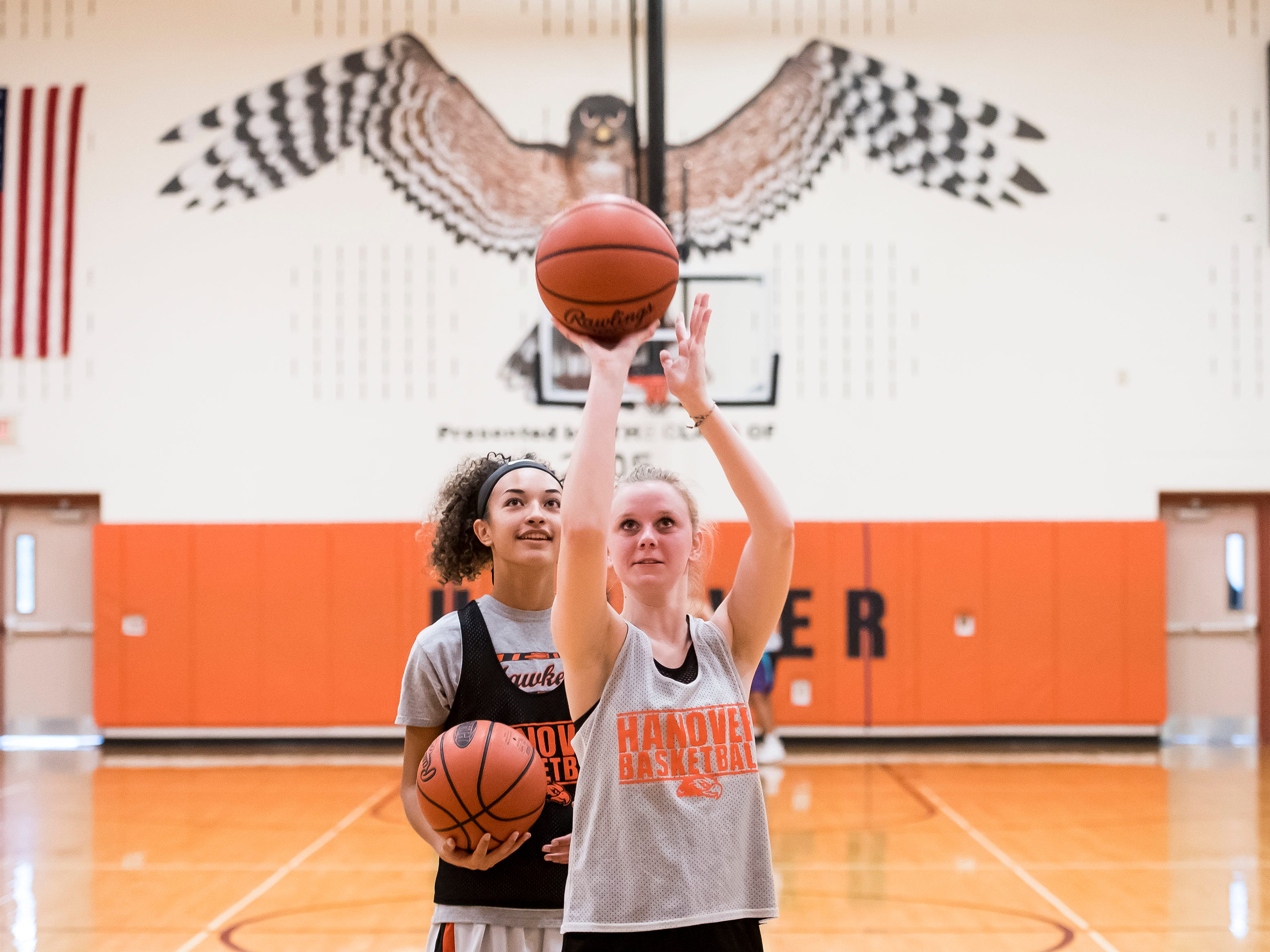 Hanover High School basketball players Abby Alban, right, and Tianna Grey practice their free throws during the first official day of winter sports practice on Friday, November 16, 2018.