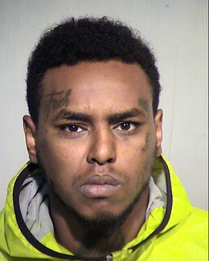 Phoenix police arrested Yusuf Kahsai, 24, in connection to the killing of 24-year-old Justin Gaines.