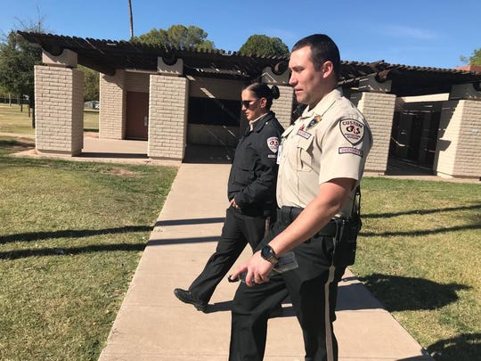 G4S security guards Amanda Ladd and Payton Murrieta patrol Clark Park in Tempe, Nov. 16, 2018.