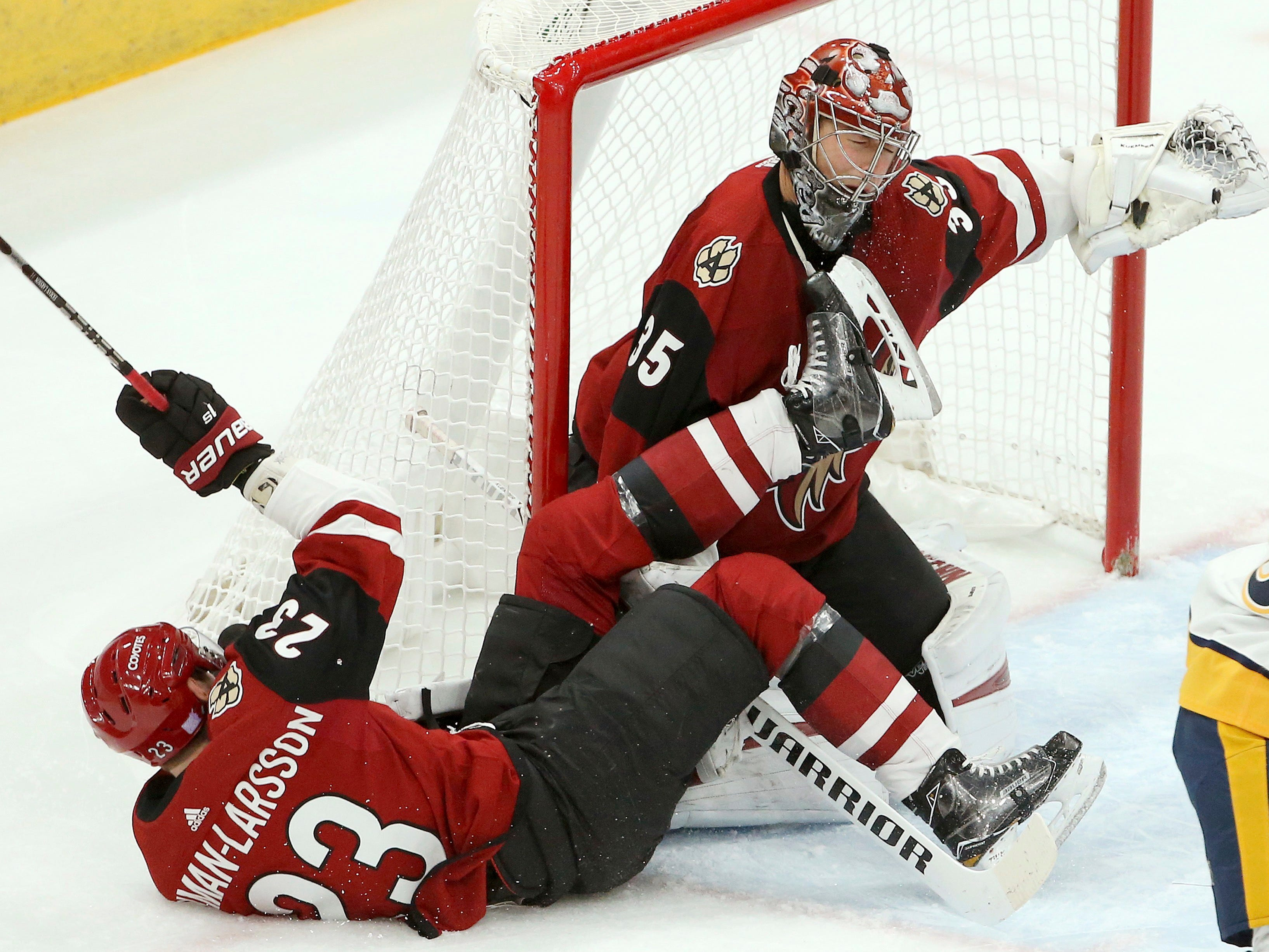 Arizona Coyotes defenseman Oliver Ekman-Larsson (23) collides with goaltender Darcy Kuemper (35) during the first period of an NHL hockey game against the Nashville Predators Thursday, Nov. 15, 2018, in Glendale, Ariz. (AP Photo/Ross D. Franklin)