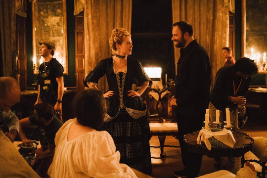 """Yorgos Lanthimos directs Emma Stone during the filming of """"The Favourite."""""""