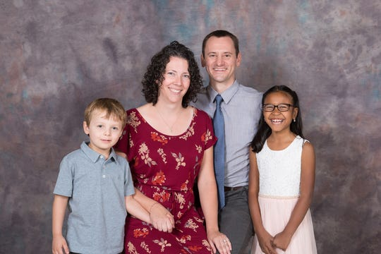 Erin and Drew Lyman's family on National Adoption Day, captured by photographer Patty Kaufman. Kaufman has volunteered her time to capture and process families' first official portrait for 15 years.