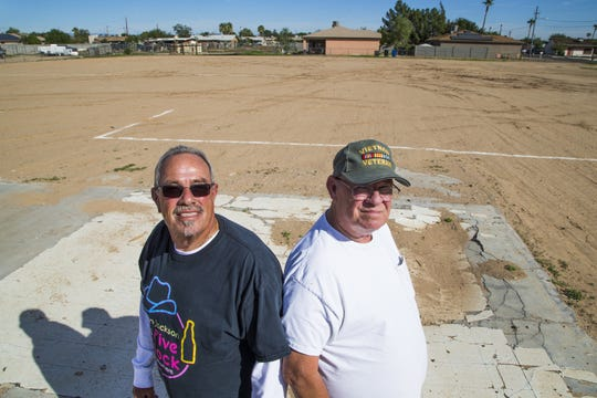 Dusty, left, and Jerry Gaines, brothers raised in Surprise, Arizona, stand on an empy lot where a baseball field may be built.  Floyd Gaines was their father and the namesake of a baseball field nearby that Floyd built for his children in the 60's. That field may be torn down to build low-income apartments.  A petition has started to stop the tear down of Gaines Park.