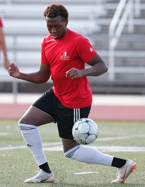 Brophy Prep defender Deric Hall runs a drill during practice in Phoenix on November 14.
