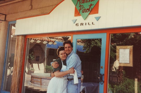 Chrysa Robertson and Tom Kaufman in front of the original Rancho Pinot Grill at Town & Country in Phoenix, AZ.