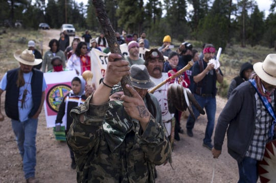 Havasupai Tribe's Intertribal Spiritual Gathering participants march to Canyon Mine in October to protest uranium mining at Red Butte.