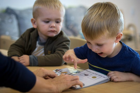 Preschool students work in their classroom Nov. 13, 2018, at the Young Mind Center in Phoenix.