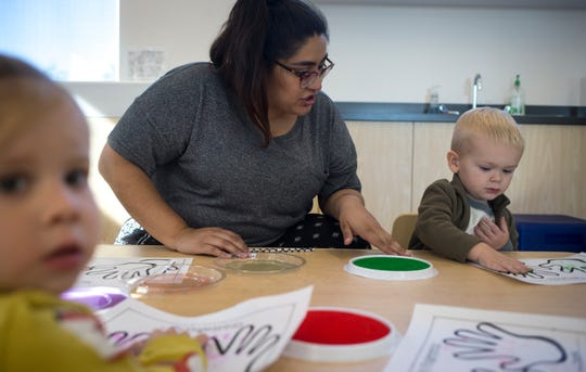 Sarah Guinea works with preschool students Nov. 13, 2018, at the Young Mind Center in Phoenix.