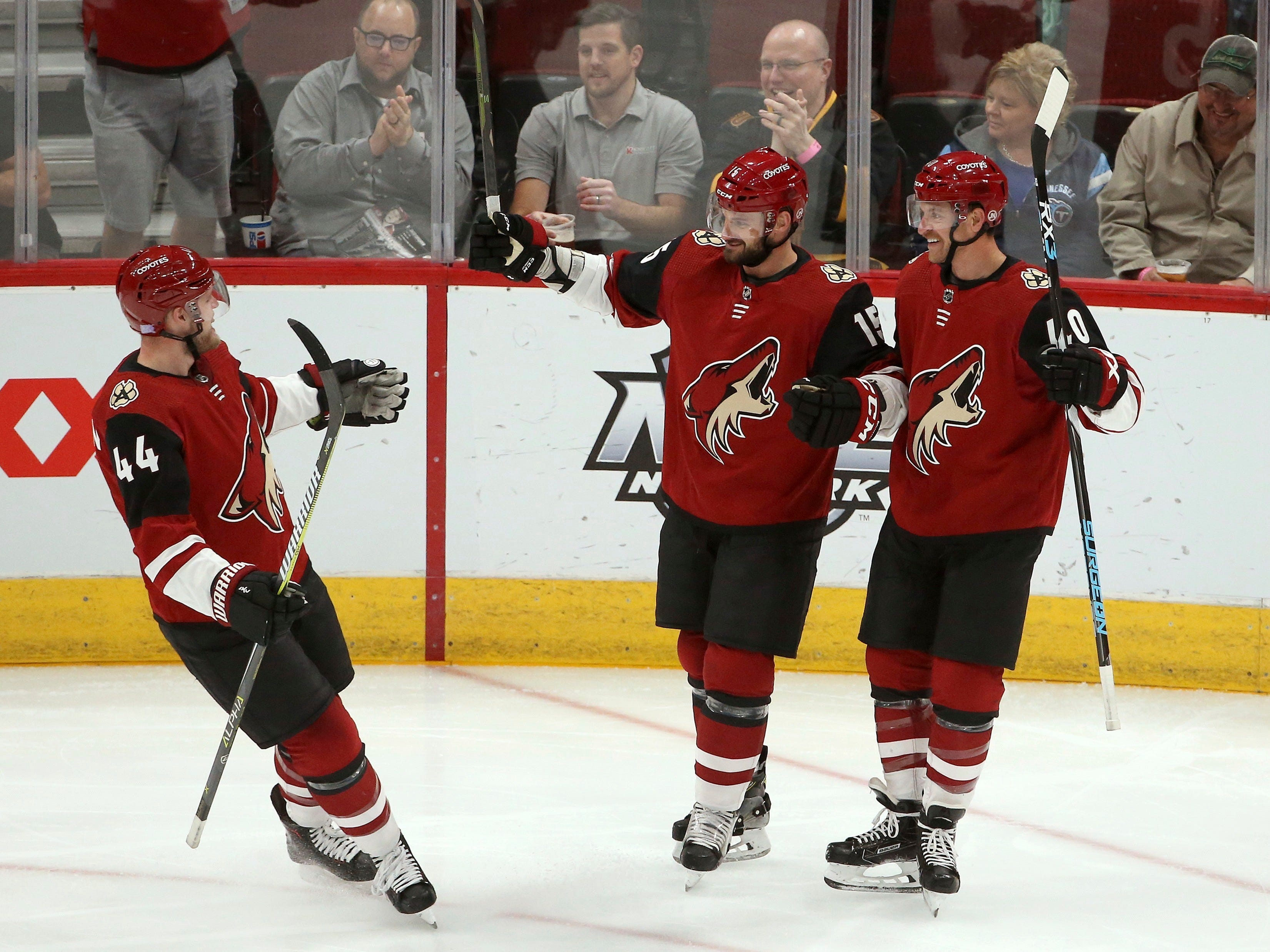 Arizona Coyotes right wing Michael Grabner (40) celebrates his goal against the Nashville Predators with defenseman Kevin Connauton (44) and center Brad Richardson (15) during the first period of an NHL hockey game Thursday, Nov. 15, 2018, in Glendale, Ariz. (AP Photo/Ross D. Franklin)