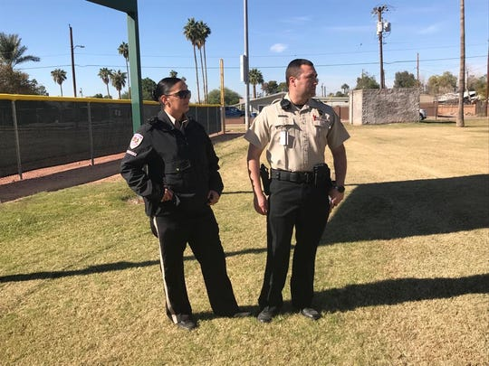 G4S security guards Amanda Ladd and Payton Murrieta patrol Clark Park in Tempe on Nov. 16, 2018.