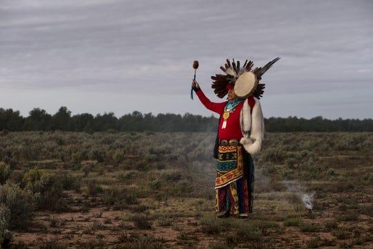 Uqualla, a Havasupai medicine man, faces the rising sun during a morning prayer at Havasupai Tribe's Intertribal Spiritual Gathering at Red Butte in October.