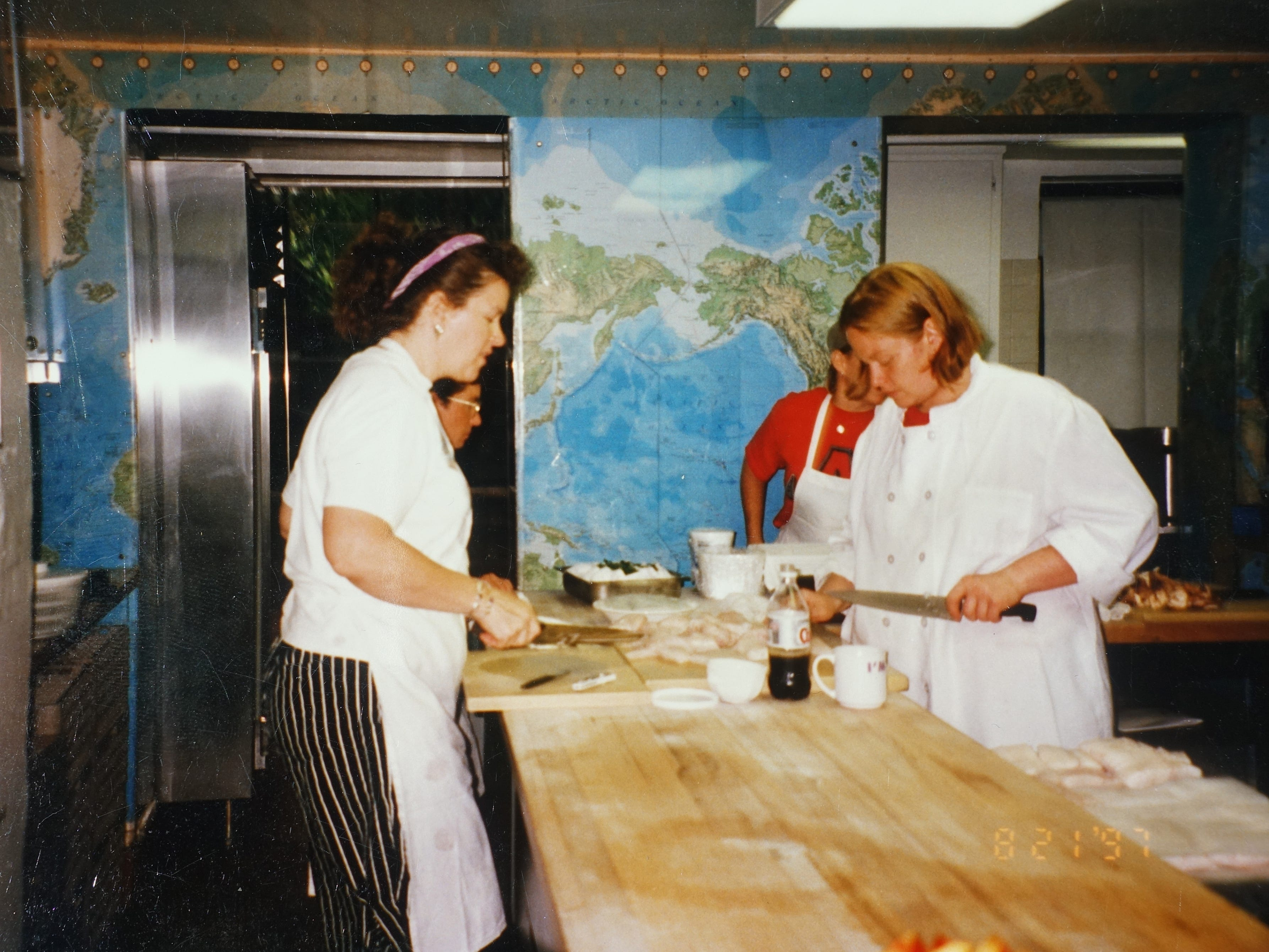 Chrysa Robertson (left) and Charleen Badman (right) cooking at the James Beard House in New York City in 1997.