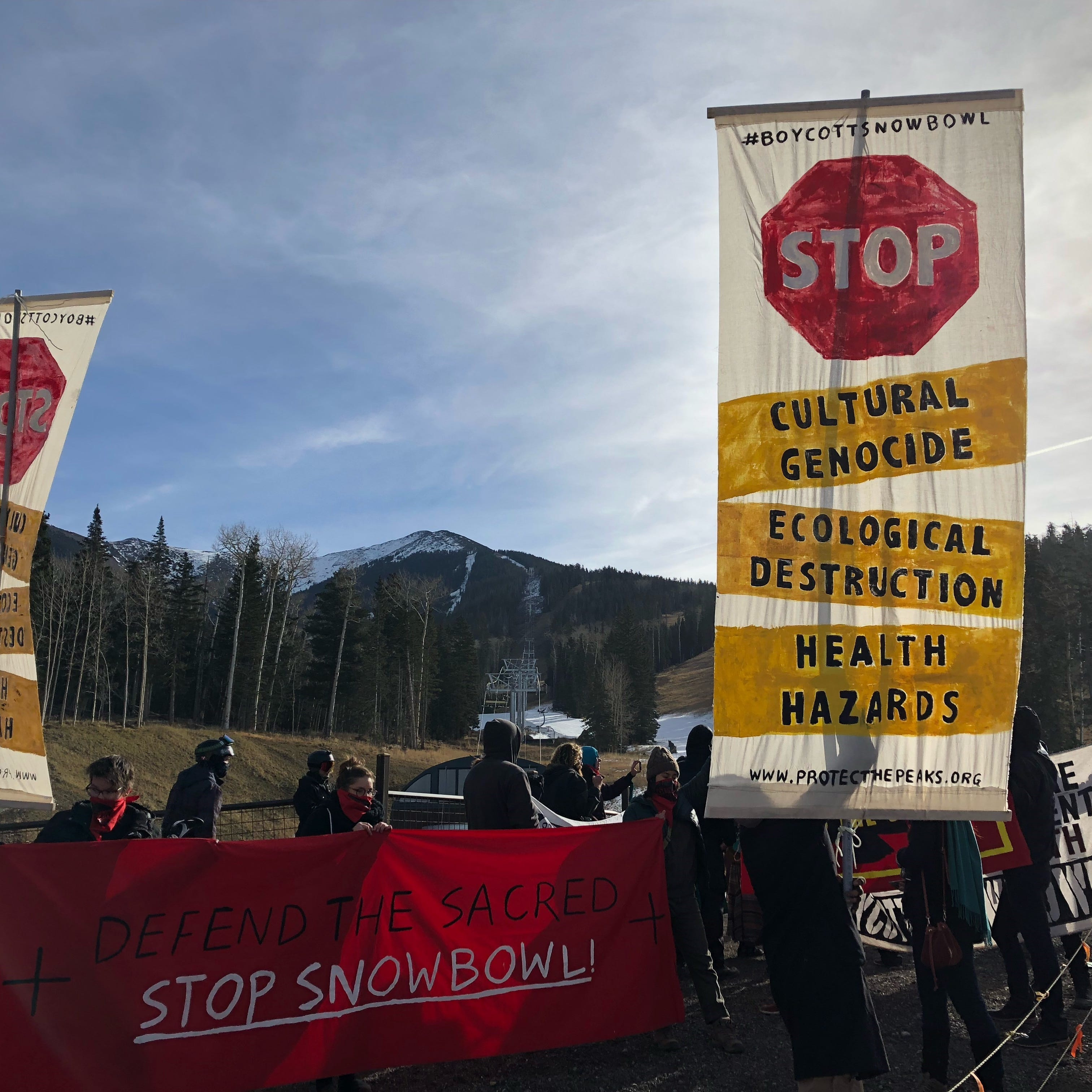 In Flagstaff, skiers and protesters show up for Snowbowl's opening day on machine-made snow