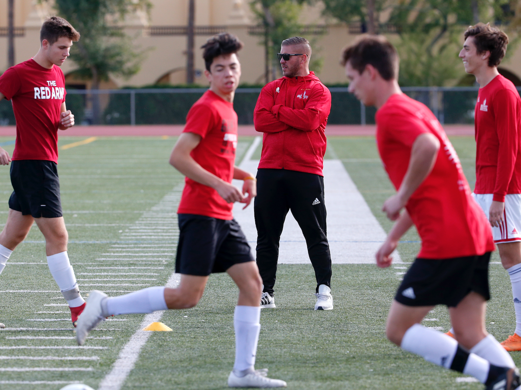 Brophy Prep head soccer coach Paul Allen instructs his team during practice in Phoenix on November 14.