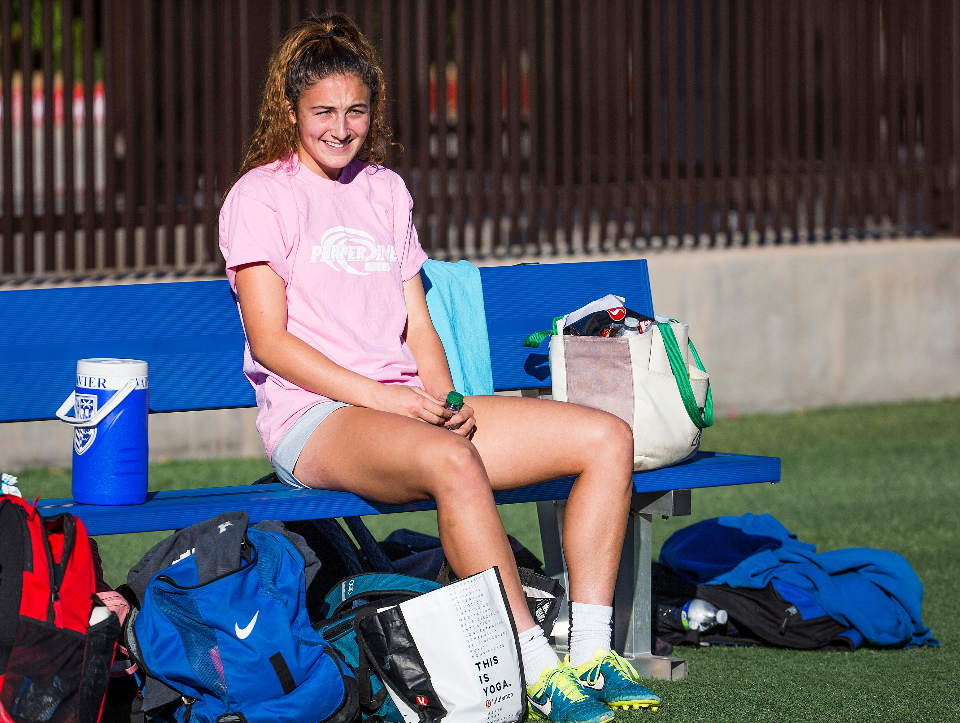 Pepperdine University soccer goalie Kinsey Ehmann takes a break after working out at Xavier College Preparatory Tuesday, November 13, 2018. She was evacuated from her school due to the fires raging in California.