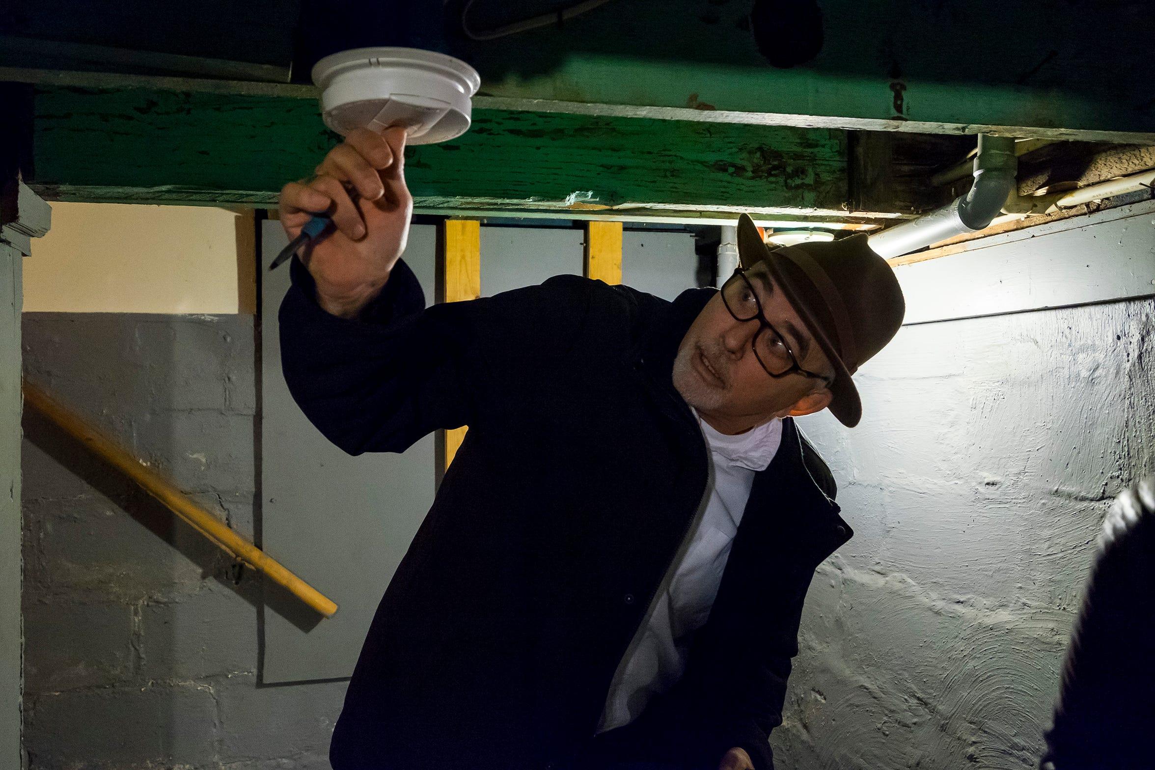 Chief Building Inspector Marvin Shagena checks a smoke detector in a Port Huron rental home Friday, Nov. 19, 2018 during a rental inspection.