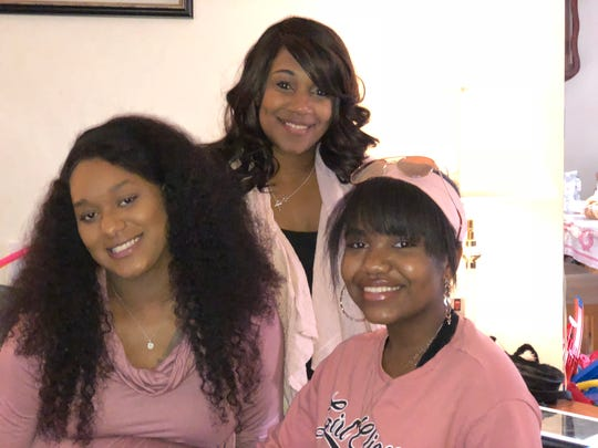 Mikaela McNeil (right) poses with her sister, Mariana (left) and aunt Andrea McNeil.