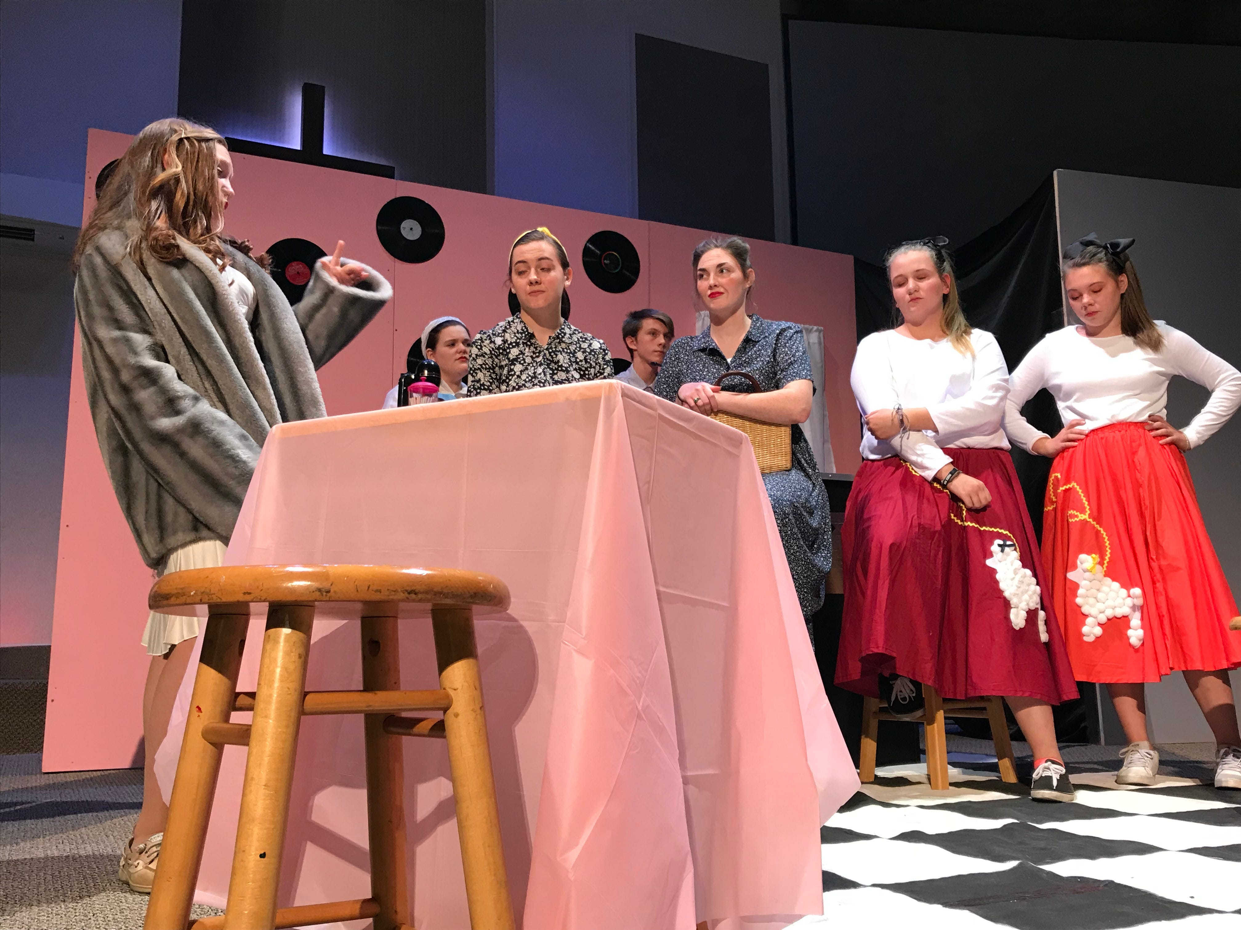 """Cumberland Valley Christian School students act out a scene during dress rehearsal for """"Murder in the Malt Shop"""" on Friday afternoon. Pictured in the foreground are, from left: Emmalyn Hott, Gracey Poe, Bethany Snyder, Hannah Kennedy and Molly Buchanan.  The public is invited to CVCS's performances of """"Murder at the Malt Shop"""" at 7 p.m. on Nov. 16 and 17 at Open Door Church, on the campus of CVCS at 600 Miller St., Chambersburg."""