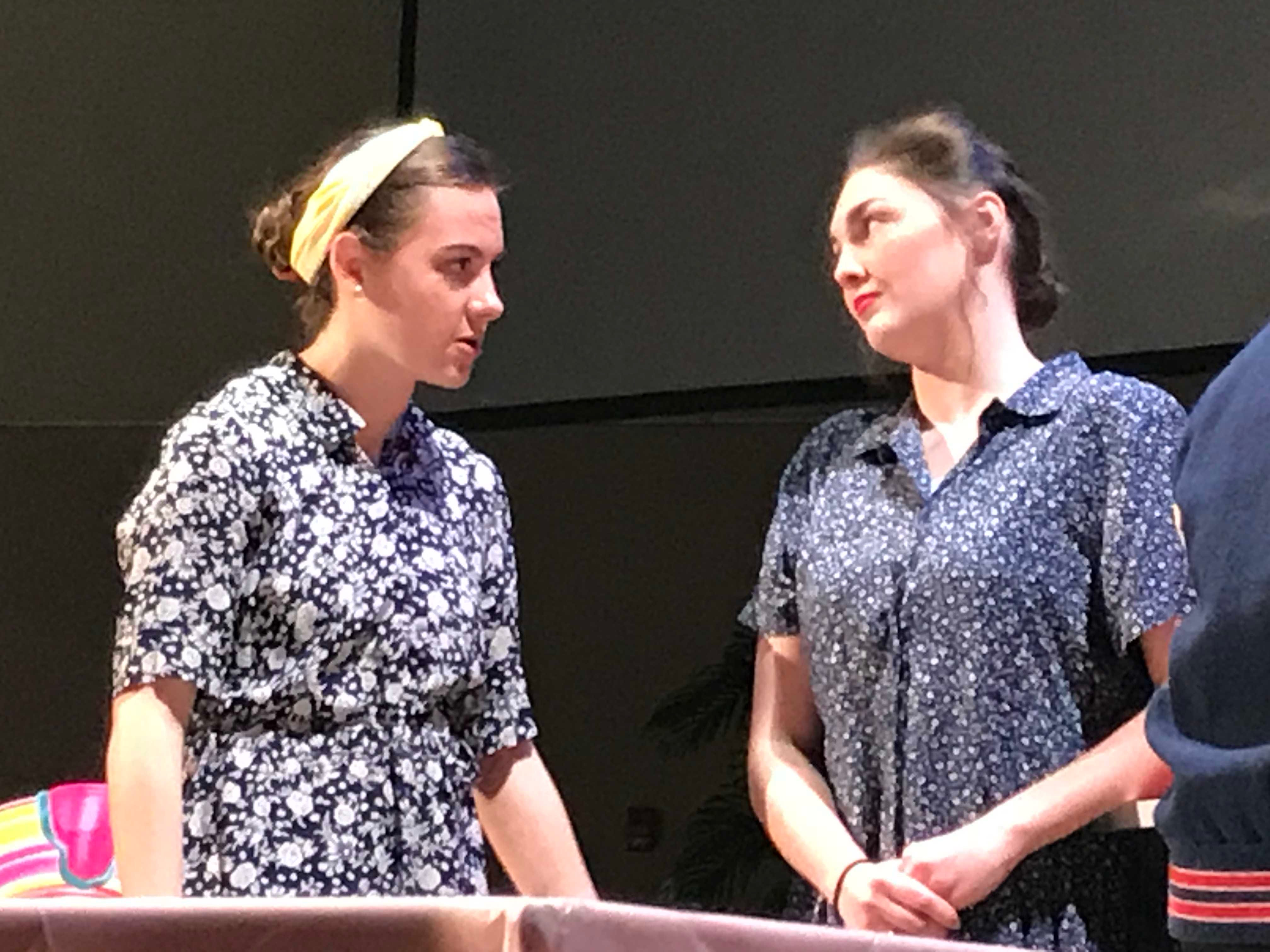 """Cumberland Valley Christian School students Gracey Poe, left, as """"Norma Dreadful"""" and Betheny Snyder, as """"Ginger Vitus"""" talk during a scene of """"Murder at the Malt Shop"""" during a dress rehearsal on Friday afternoon. The public is invited to see the play at 7 p.m. tonight at the Open Door Church, which is located in the Cumberland Valley Christian School complex, at 600 Miller St., Chambersburg."""