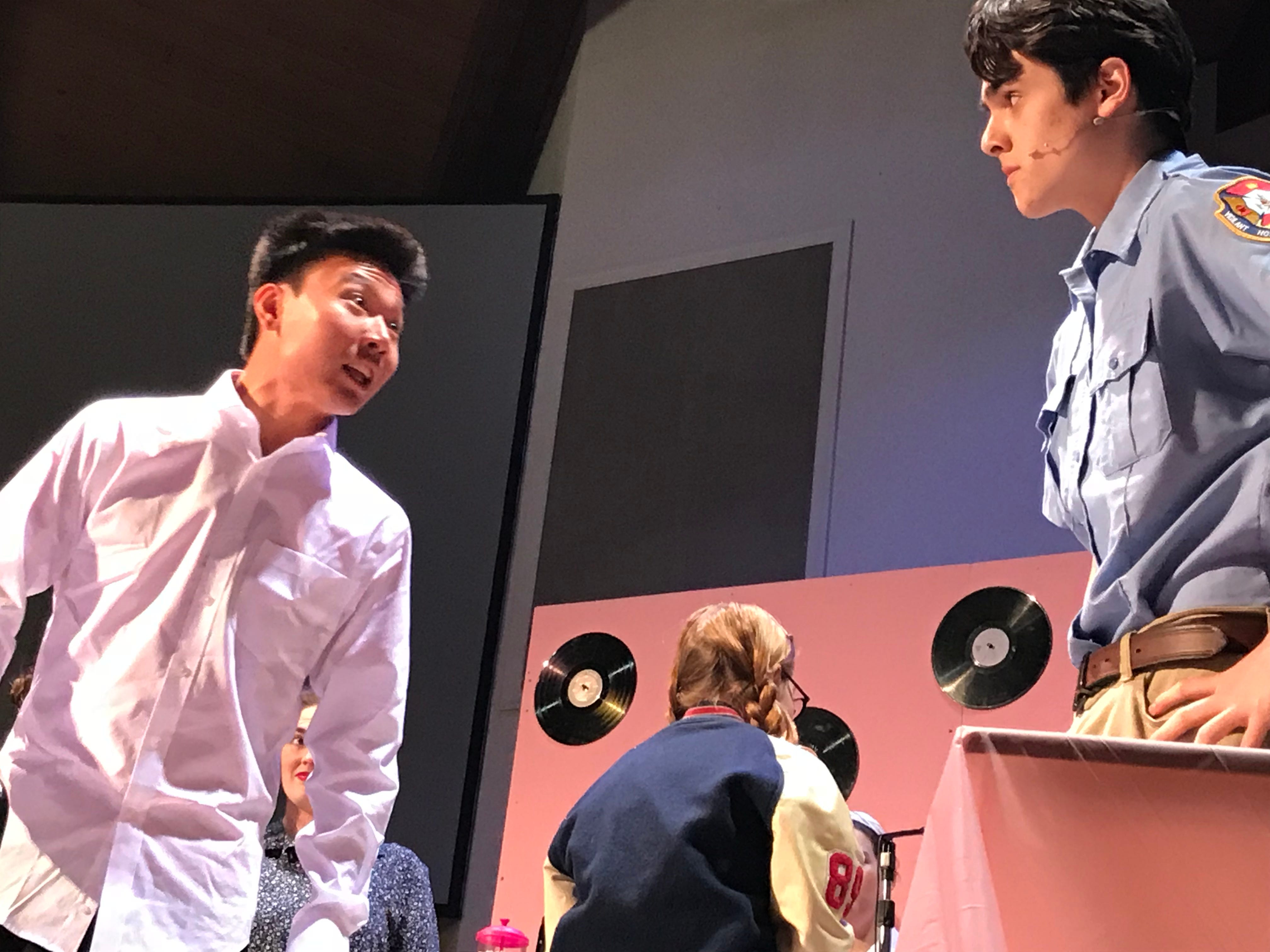 """Cumberland Valley Christian School sophomore David Jeong, playing the curmudgeon high school principal, and Gianni Castellano, playing the town sheriff, argue in a scene of """"Murder at the Malt Shop,"""" during a dress rehearsal on Friday afternoon. The public is invited to see the play at 7 p.m. tonight at the Open Door Church, which is located in the Cumberland Valley Christian School complex, at 600 Miller St., Chambersburg."""