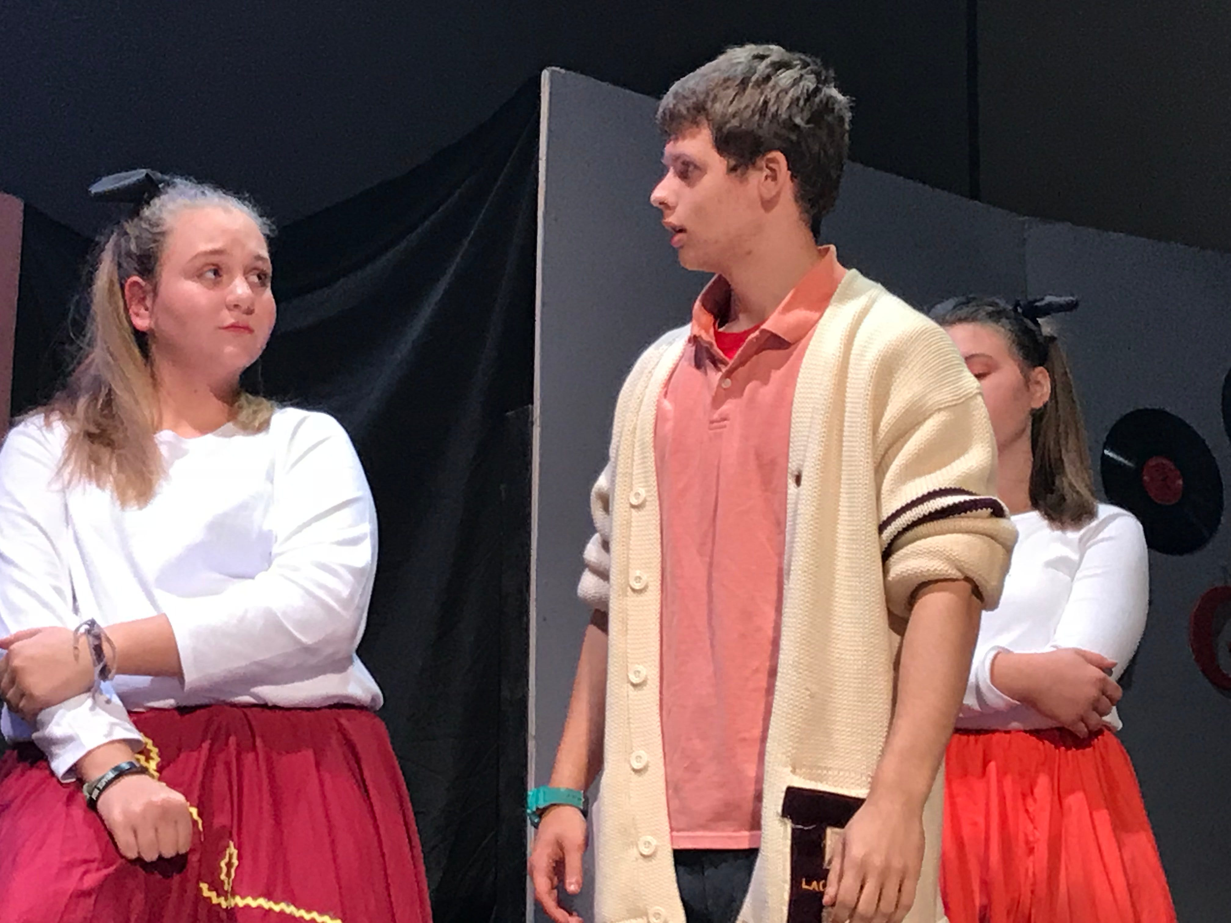 """Hannah Kennedy and Thomas McVey act out a scene as """"Bobby Pin"""" and """"Jim Shorts,"""" respectively, in a dress rehearsal for """"Murder in the Malt Shop"""" on Friday afternoon.  The public is invited to CVCS's performances of """"Murder at the Malt Shop"""" at 7 p.m. on Nov. 16 and 17 at Open Door Church, on the campus of CVCS at 600 Miller St., Chambersburg."""