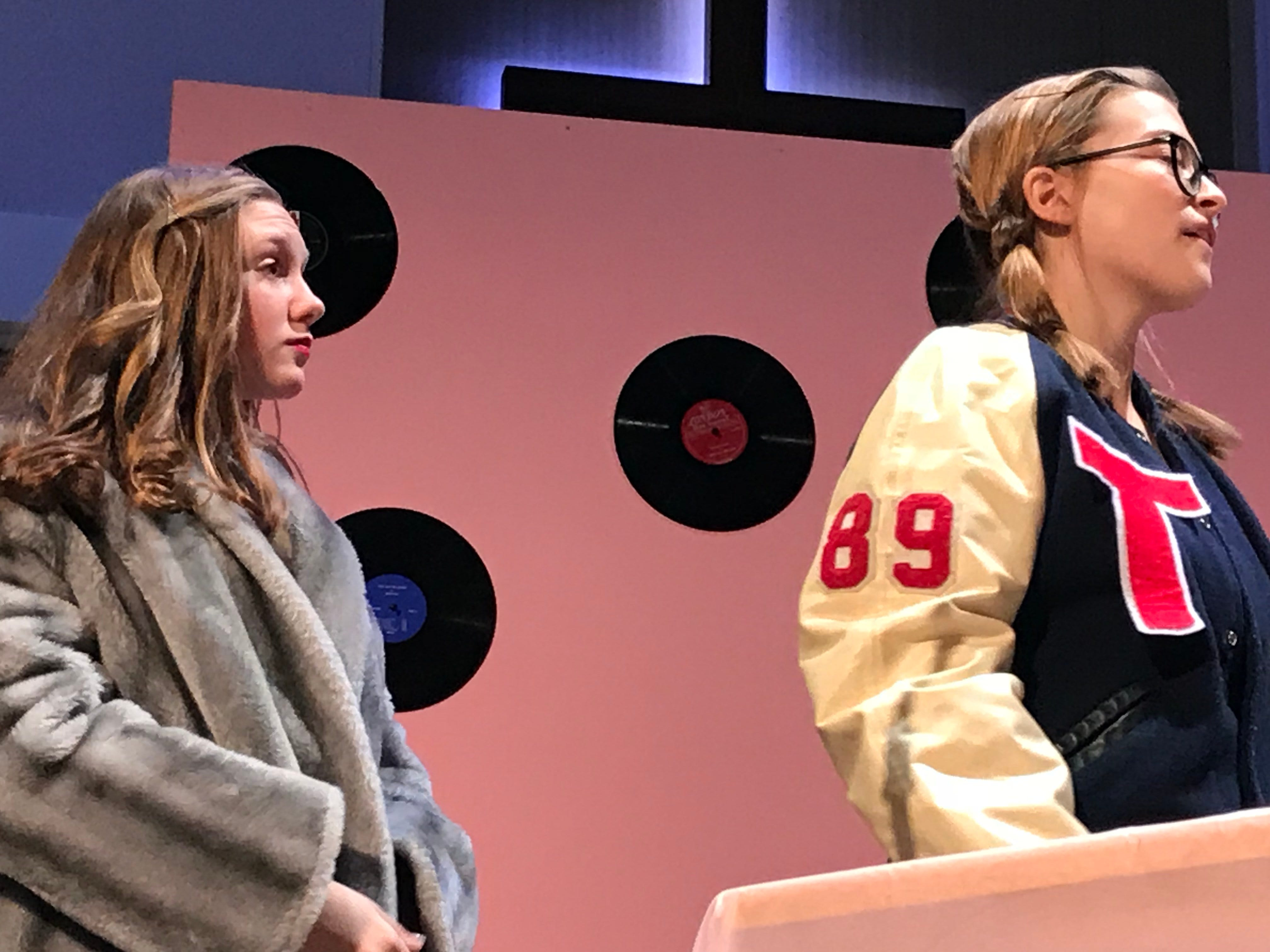 """Cumberland Valley Christian School students Emmalyn Hott, left, playing """"Holly Wood,"""" and Marlee Stake, playing """"Wynn Fairly,"""" act out a scene in """"Murder at the Malt Shop"""" during a dress rehearsal on Friday afternoon. The public is invited to see the play at 7 p.m. tonight at the Open Door Church, which is located in the Cumberland Valley Christian School complex, at 600 Miller St., Chambersburg."""