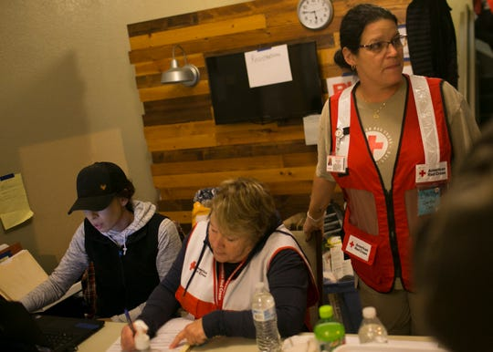 Red Cross volunteers work in the entrance to the Neighborhood Church Red Cross Shelter in Chico, California on Nov. 14, 2018.