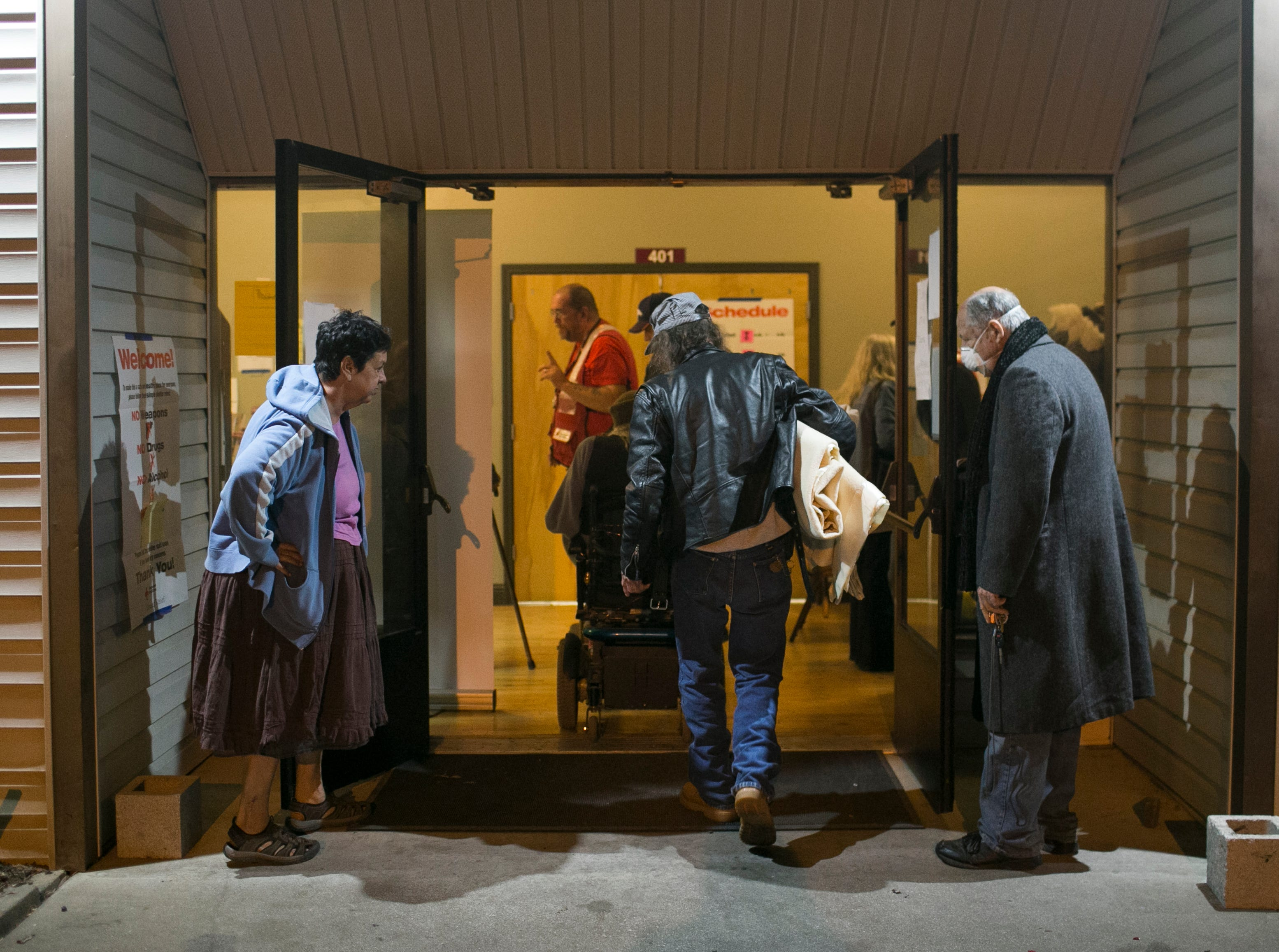 Evacuees walk into the Neighborhood Church Red Cross Shelter in Chico, California on Nov. 14, 2018.