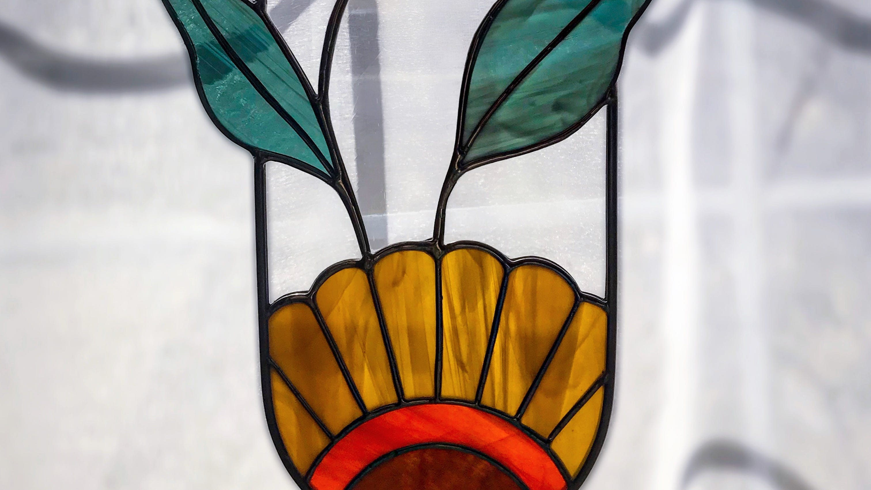 Gold Fever Glass Co. makes stained glass hangings to hang in your favorite window.