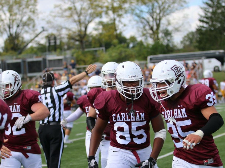 Harrison Rice (85) and Kobe Walker (35) during an Earlham football game.