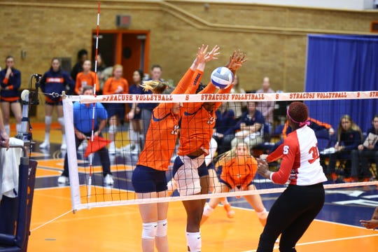 Syracuse's Santita Ebangwese, center, teams up to make a block against North Carolina State