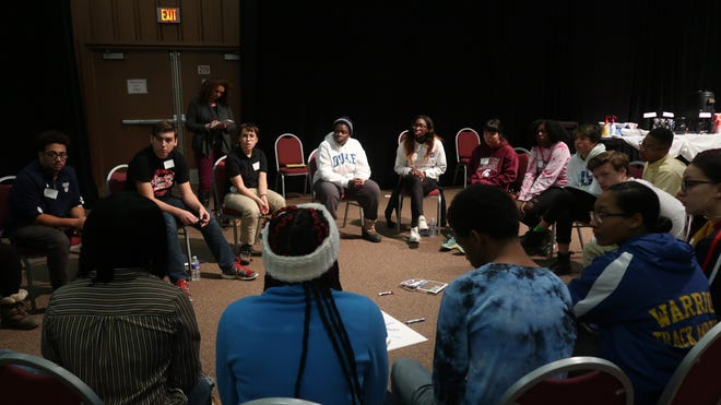 Discussion circle with students at the ROC 2 Change summit.