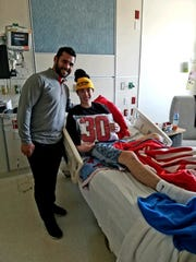 Retired Buffalo Sabres captain and Rochester native Brian Gionta pays McQuaid senior defenseman Cooper Petrone a visit.