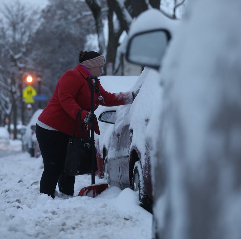 Early season winter blast closes schools, prompts travel advisories and slows commute