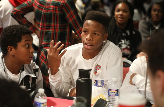 Kendal Burno, a freshman at McQuaid Jesuit, center, leads a discussion on race at his table of McQuaid schoolmates during the Individual School Work Session at the Roc2Change student summit on race held Friday, Nov. 16, 2018 at the Wegmans Conference Center in Gates. About 450 students from 37 high schools participated in the daylong student-led summit.
