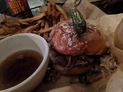 The beef in the beef on 'weck at the Angry Goat  is tender, juicy and deeply flavorful.
