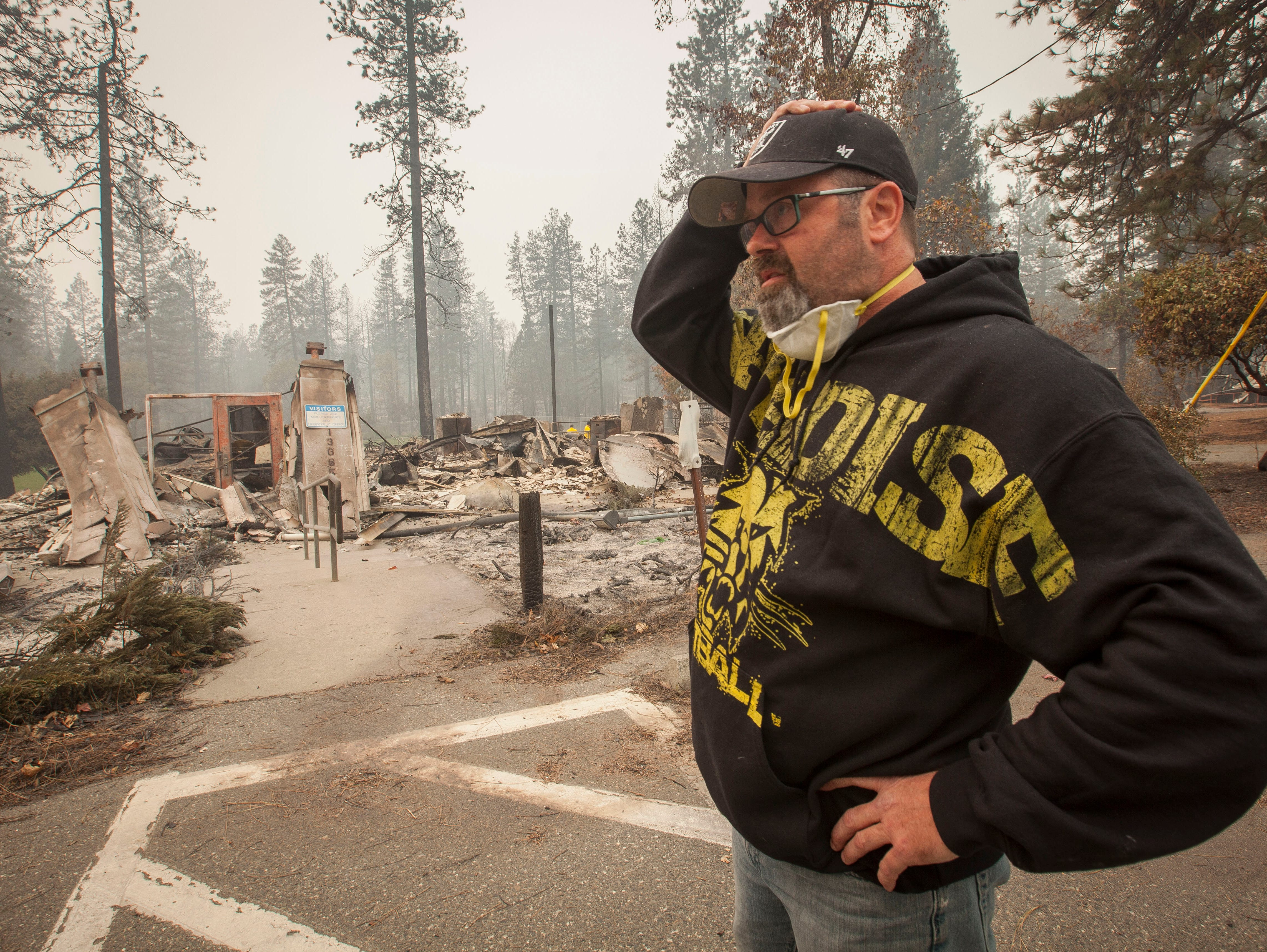 Paradise Unified School Board member Richard Gingery Jr. cannot believe the devastation as he looks over the remains of the continuation high school in Paradise, CA, after the Camp Fire devastated the area.